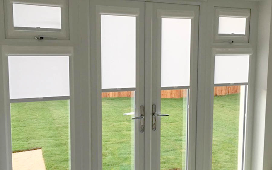 Perfect Fit Blinds, Bathgate, West Lothian. A stylish set of patio doors and windows with perfect fit blinds.